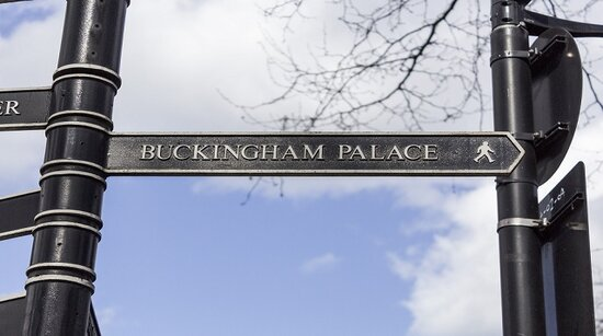Buckingham Palace road sign with blue sky