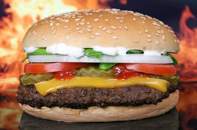 Trademark Bic Mac Hamburger in front of fireplace